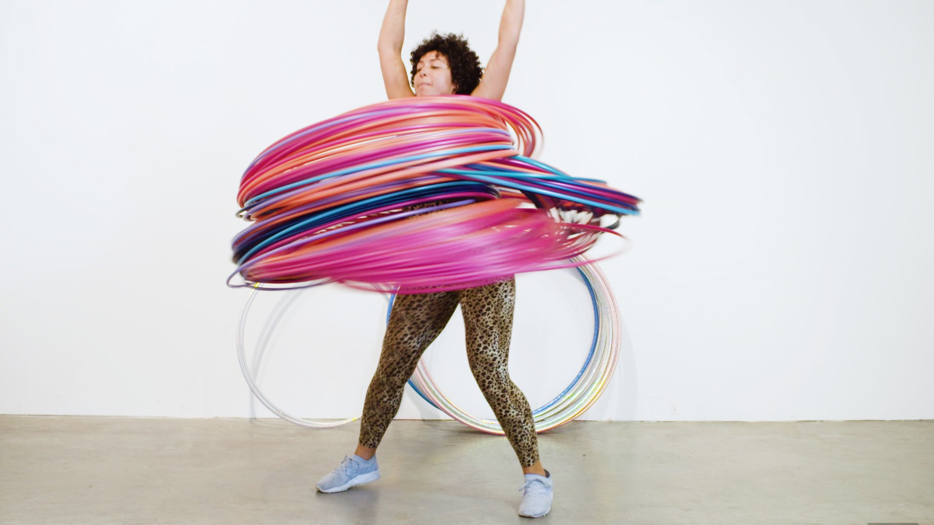 One Woman Pushes Hula-Hooping to Its Absurd, Glittery Limits