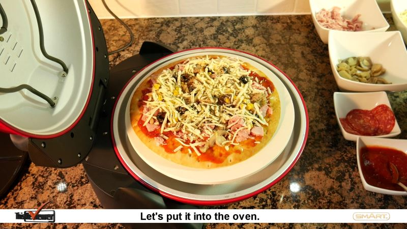 the_pizza_oven_made_by_smart_called_the_pizza_maker making some pizzas in the pizza maker